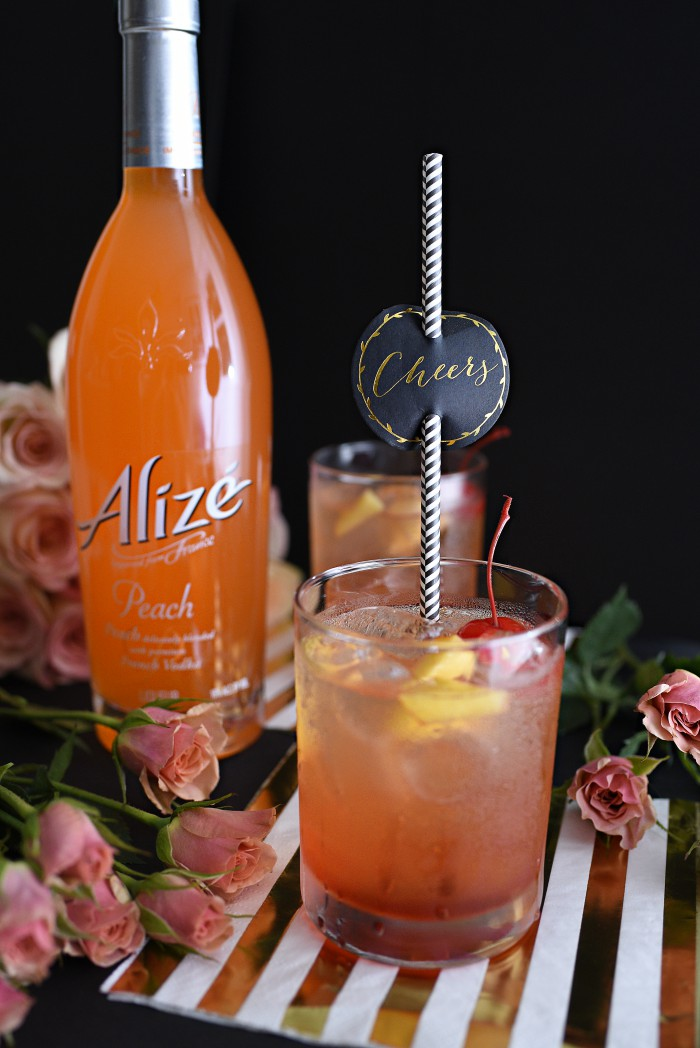 Alize peach vodka cocktail.